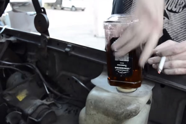 What This Guy Does With a Bottle of Whiskey and Windshield Wipers is Ridiculous