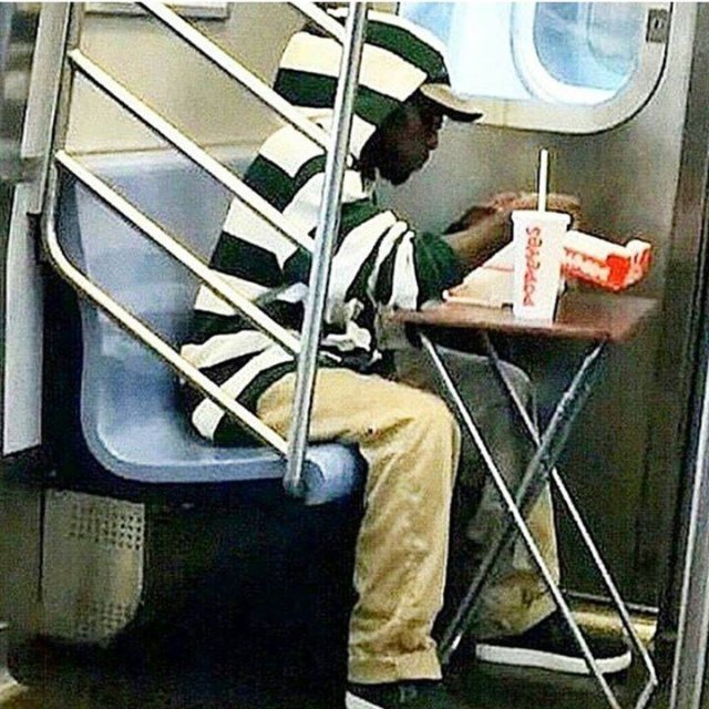 This Guy Mastered Eating Lunch on the Subway