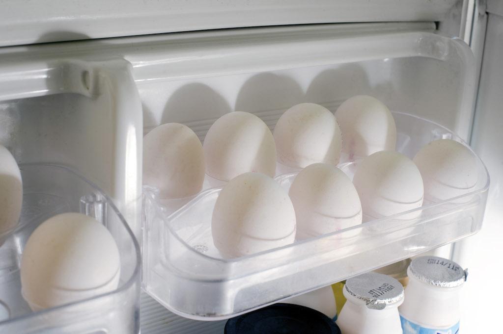 Tray of farm fresh eggs in the refrigerator