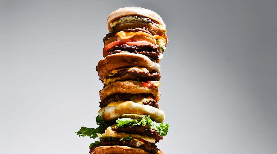 What 10 Iconic Burgers Look Like When Combined Into One