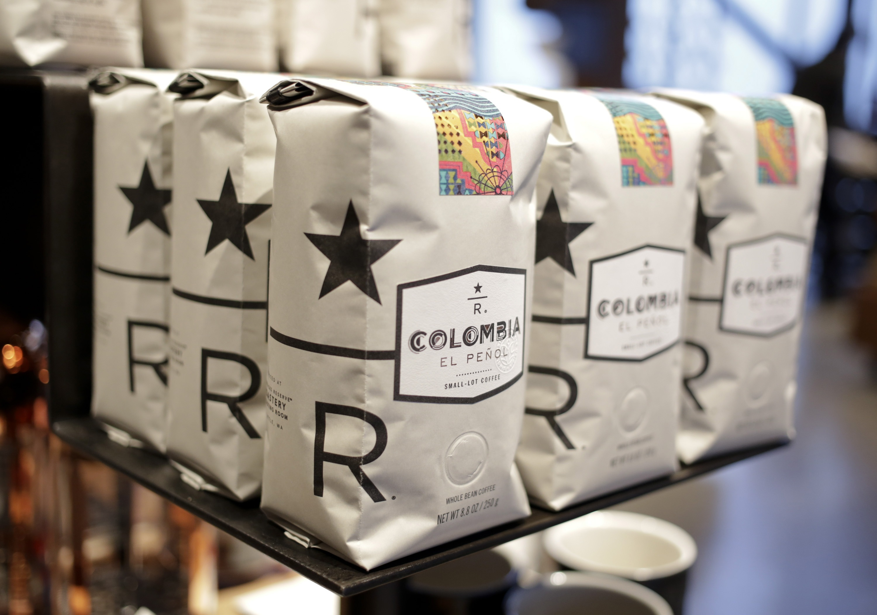 "Bags of Starbucks small-lot coffee featuring the new ""reserve"" logo is on display at a preview of its new Reserve Roastery and Tasting Room in Seattle"