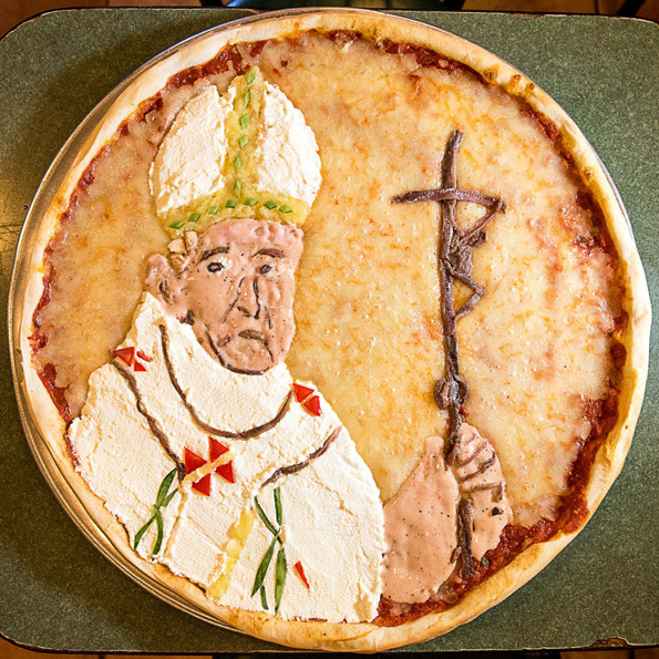 NEW YORK - September 21: PULSE - A portrait of Pope Francis on a pizza done in pizza toppings at BLEECKER STREET PIZZA, 69 7th Avenue South in Manhattan. September 21, 2015. (Photo by Gabi Porter)
