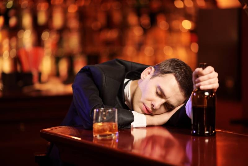 young-man-passed-out-bar