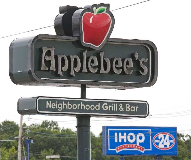 An Applebee's sign appears opposite an IHOP sign on Route 46 in Totowa, New Jersey, Monday, July 16, 2007. Ihop Corp., the largest U.S. pancake-house chain, agreed to buy Applebee's International Inc. for $1.9 billion and sell securities backed by franchisee fees to finance the purchase. Photographer: Emile Wamsteker/Bloomberg News.