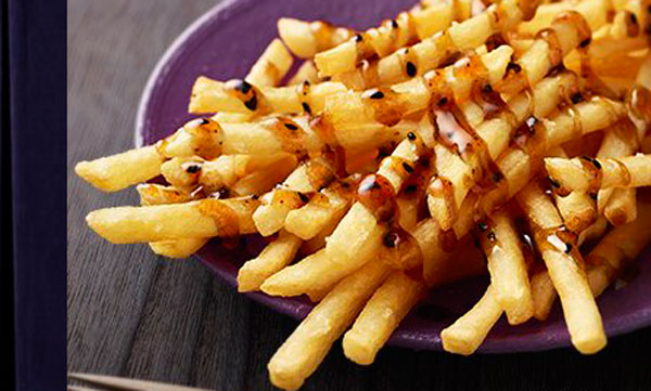 McDonald's Sweet New Fries Are Topped With Honey & Black Sesame